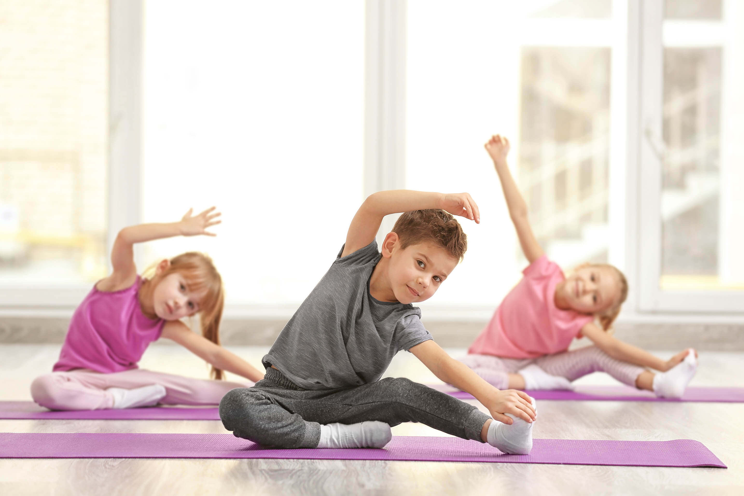 young children on yoga mats