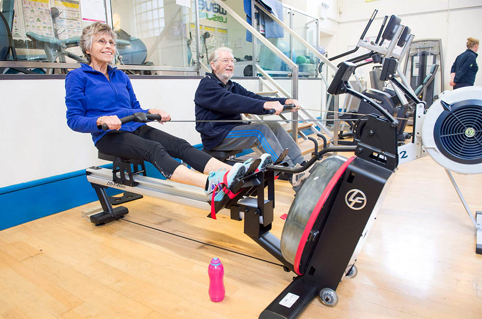 Senior on a rowing machine