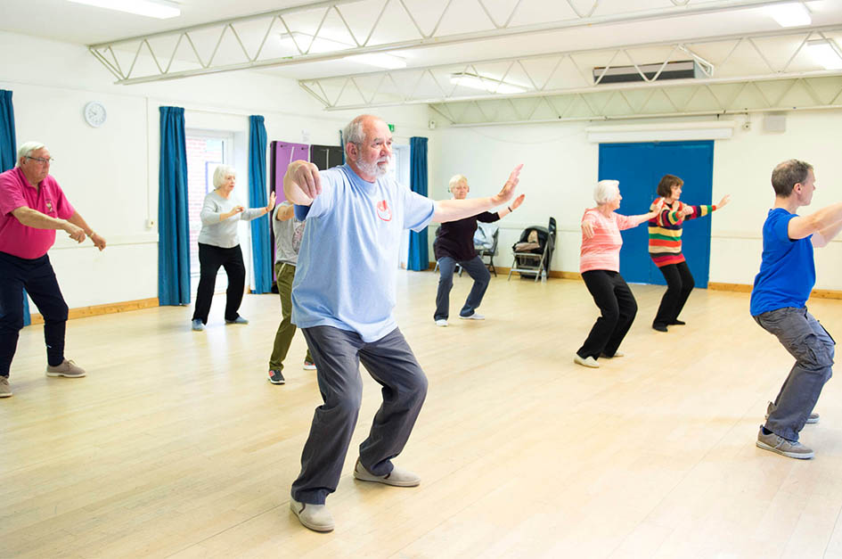 Older people doing tai chi