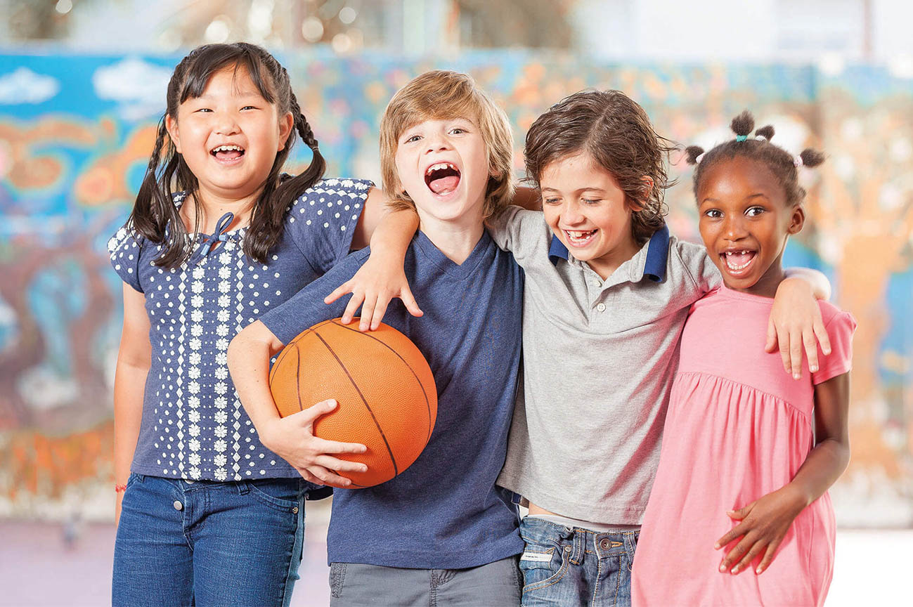 Group of children holding a basketball
