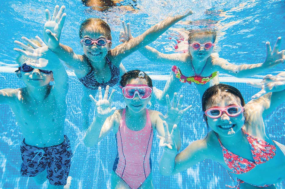 Kids waving underwater