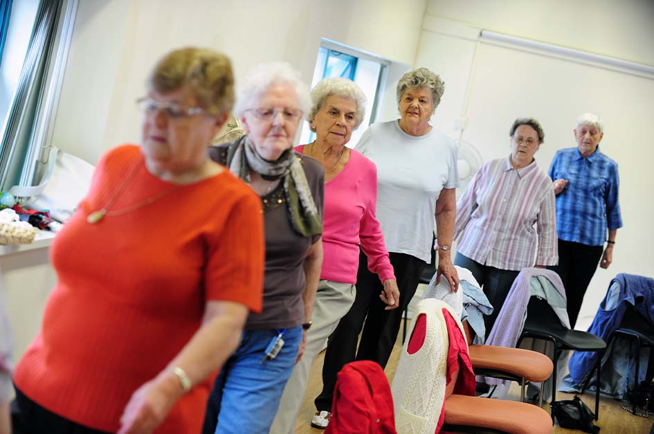 Older people in chair based exercise class