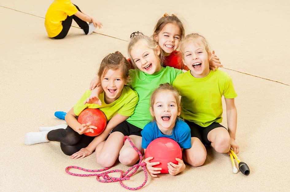 children with sports equipment