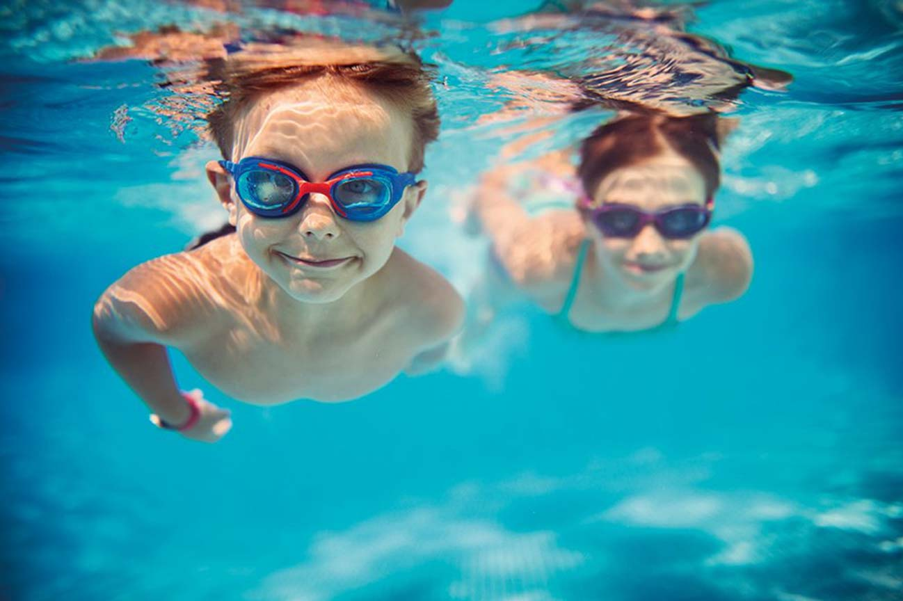 children smiling underwater