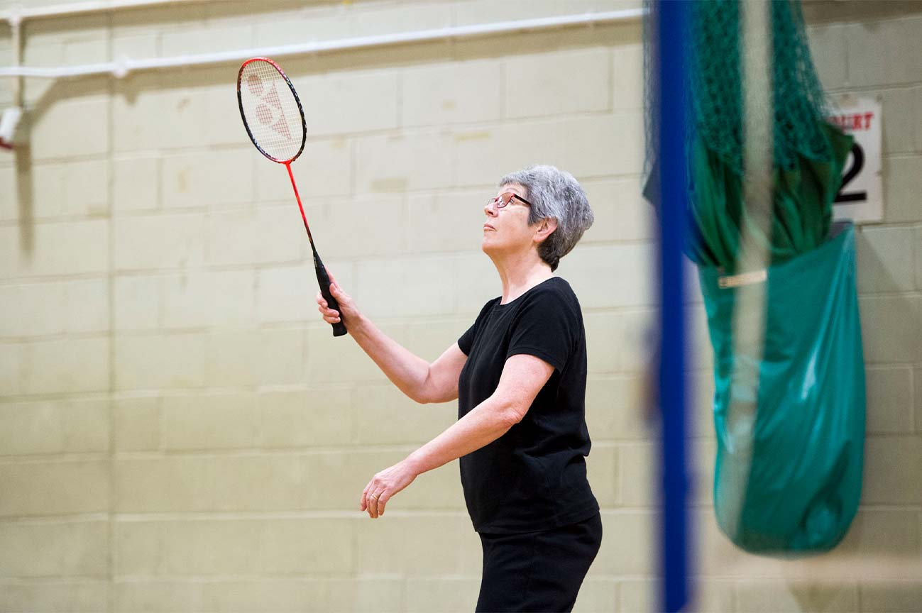 Senior playing badminton