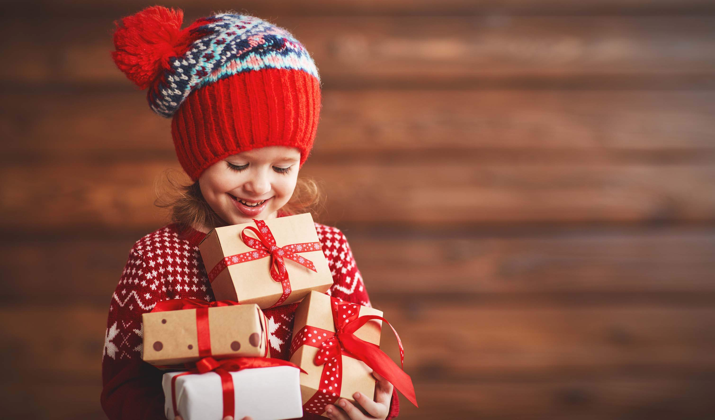 Girl in a hat with presents