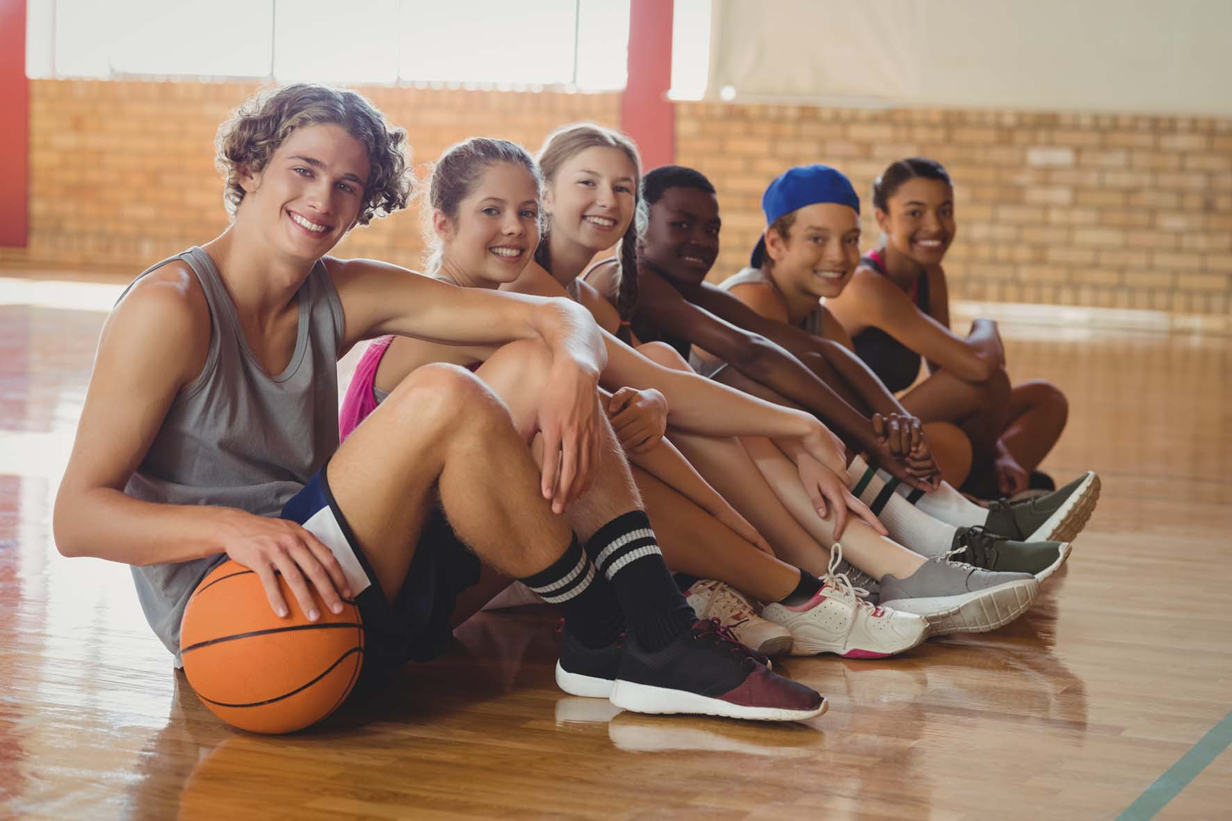 teens in a sports hall with basketball
