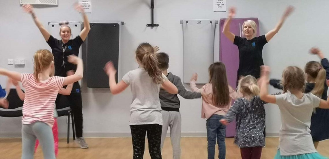 Emma and daisy teaching with kids