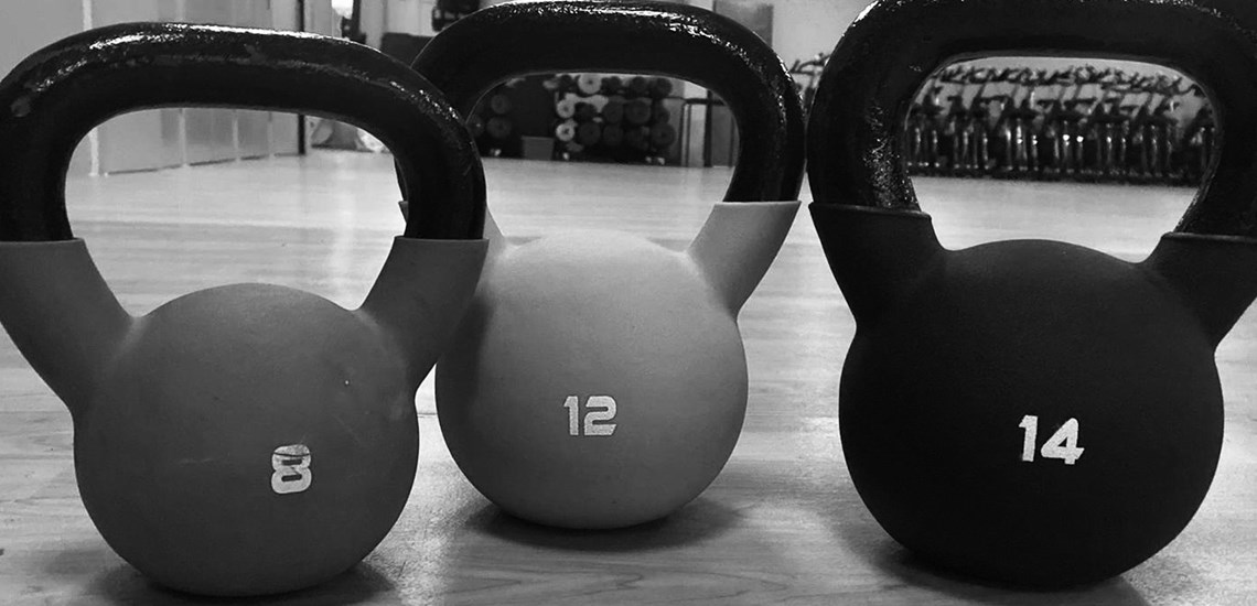a group of kettlebells in black and white
